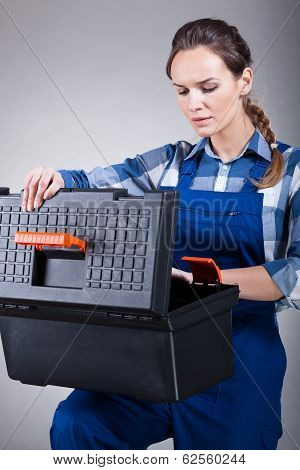 Woman Opening A Toolbox