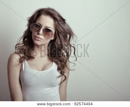 Beautiful teen girl with sun glasses. Fashion girl. Toned.