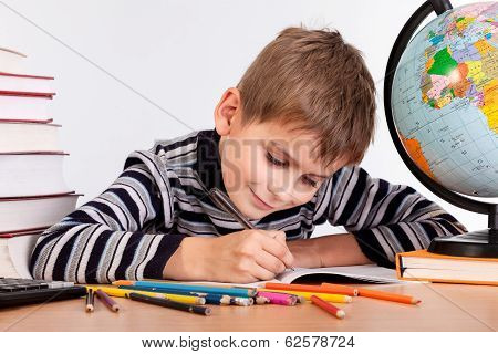 Cute Schoolboy Is Writting