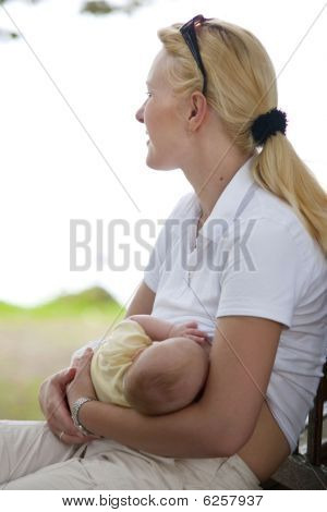 Nursing baby in the park