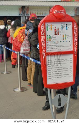 SOCHI, RUSSIA - FEBRUARY 12, 2014: Menu against people waiting in the line to cafe in Olympic Park. Despite expensive prices, people must wait in lines for getting food and drinks