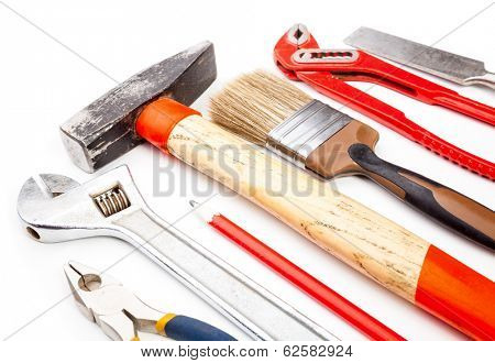 Various old used tools on white background