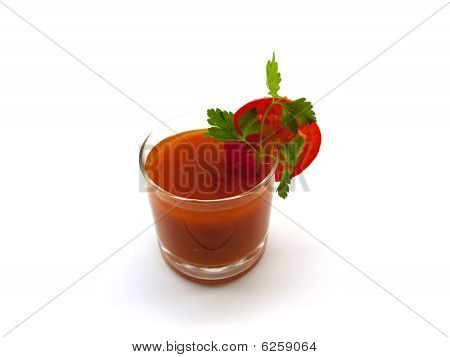 Glass Of Tomato Juice With A Segment Of A Tomato And Parsley