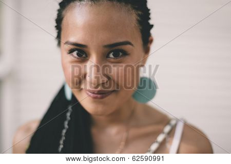 young  woman on the white wall background