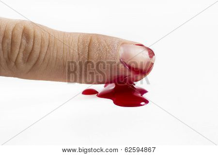 Wound With Blood On Finger Over White