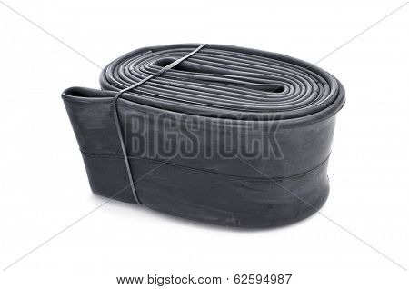 a packed bicycle inner tube on a white background