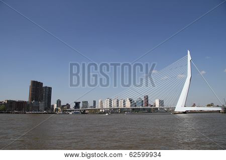 Rotterdam, The Netherlands - June 15th, 2013: Erasmusbridge and skyline Rotterdam against blue sky
