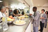 stock photo of homeless  - Kitchen Serving Food In Homeless Shelter - JPG