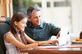 image of 13 year old  - Father And Teenage Daughter Looking At Laptop Together - JPG