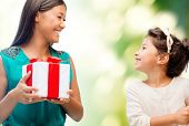 holidays, presents, christmas, family, child and x-mas concept - happy mother and child girl with gi