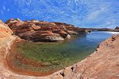 Turquoise water in the red desert. Flood of the artificial lake Powell photographed Fisheye lens