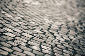 stock photo of paved road  - Paving Stone surface with shallow depth of field in retro style