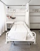 stock photo of stretcher  - one white hospital bed in a room - JPG