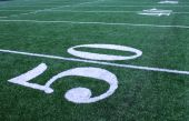 foto of football field  - 50 yard line on an american football field - JPG