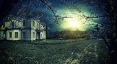 picture of spooky  - Spooky haunted house at dusk - JPG