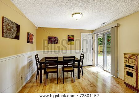 Dining Room With Exit To Backyard Patio Area
