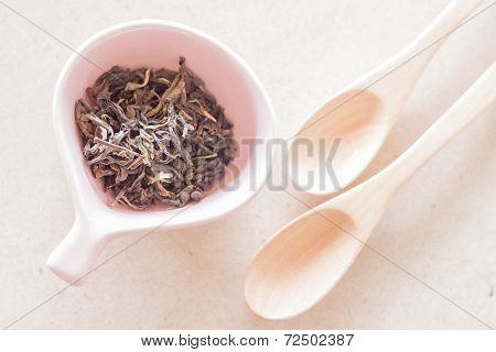Oolong Tea In Ceramic Cup And Empty Wooden Spoons