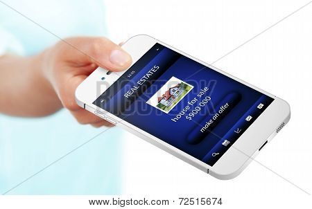 Hand Holding Mobile Phone With Real Estate Offer Isolated Over White
