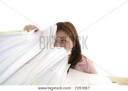 Young Woman Looking In A Stack Of Papers