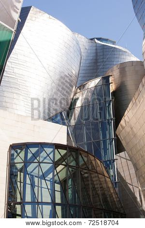 BILBAO, SPAIN - SEP 3 2014 : The Guggenheim Museum reflects early morning sunlight.