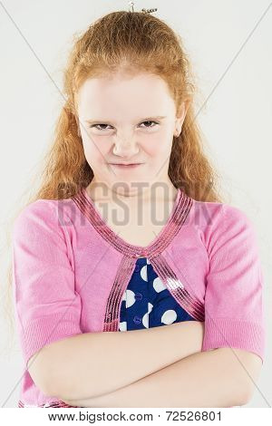 Natural Portrait Of Caucasian Red-haired Angry Little Girl With Hands Folded