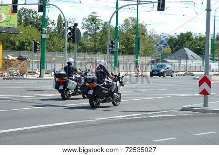 Two Police Officers On Motorcycles On Street In Poznan, Poland