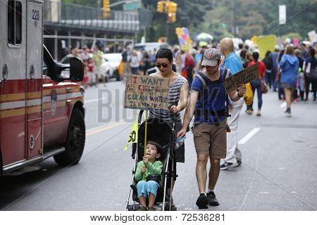Marcher in stroller with sign