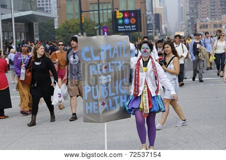 Costumed marcher with sign