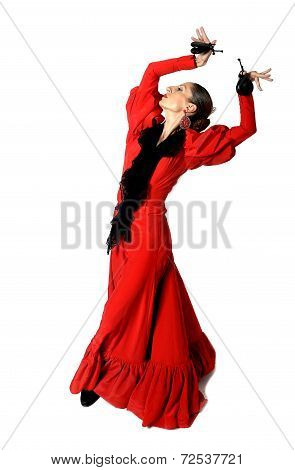 Young Spanish Woman Dancing Flamenco With Castanets In Her Hands