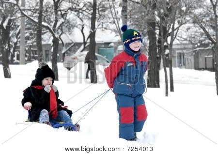 Brother Pulling Sister On Sledge