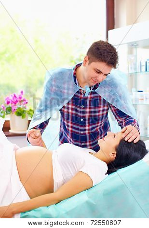 Partner Soothing Pregnant Woman During Affiliate Childbirth