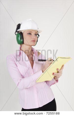 Businesswoman In Helmet Holding Documents
