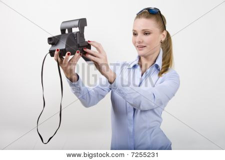 Beautiful Young Woman Holding Photocamera