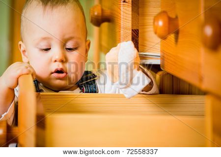 Domestic chores - baby opens drawer