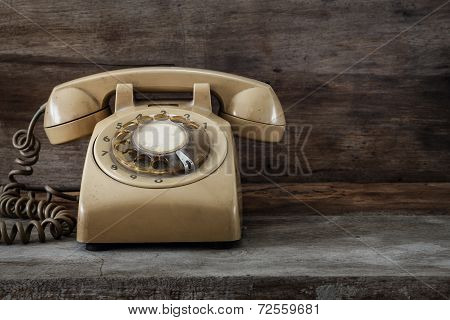 Vintage Telephone On An Old Wood Table