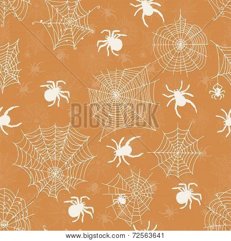 Vector seamless pattern with white spiders on an orange background . Vector illustrations