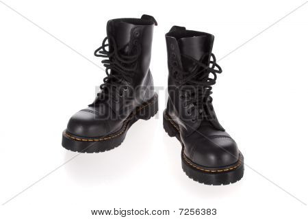 Military style black boots isolated on white