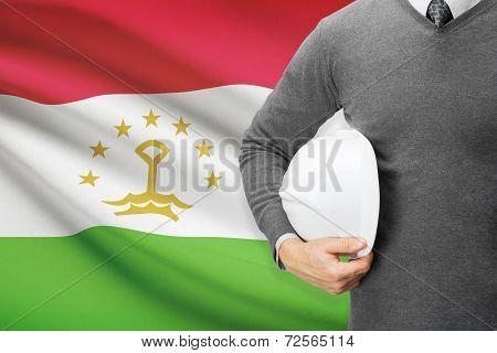 Architect With Flag On Background  - Tajikistan