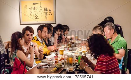 Chinese People In Restaurant