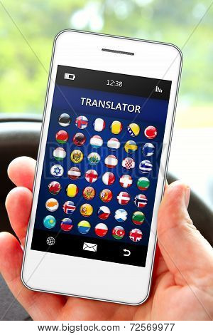 Hand Holding Mobile Phone With Language Translator Application
