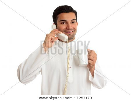 Friendly Smiling Ethnic Businessman On Telephone