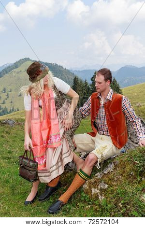 Couple flirting in the Bavarian costumes