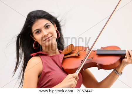 Teenage girl enjoying playing violin