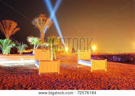 Beach Of Luxury Hotel In Night Illumination On Palm Jumeirah Man-made Island, Dubai, Uae