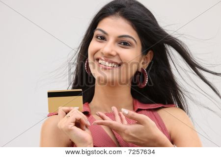 Smiling sexy girl with credit card