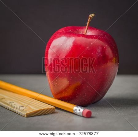 School time red apple, pencil, ruler