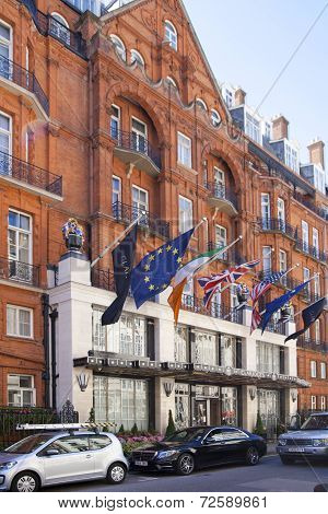 International flags above the main entrance of luxury Claridges hotel