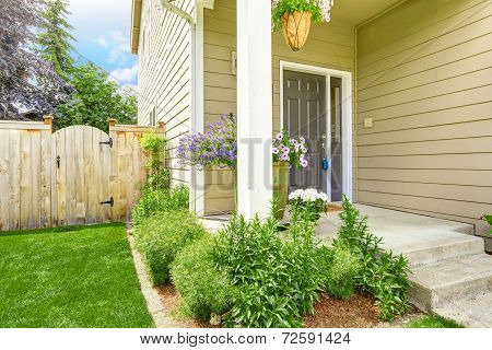 Entrance Porch With Flower Bed And Wooden Fence