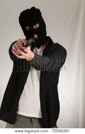Man Holding a Pistol Gun