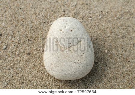 Smile on pebble stone